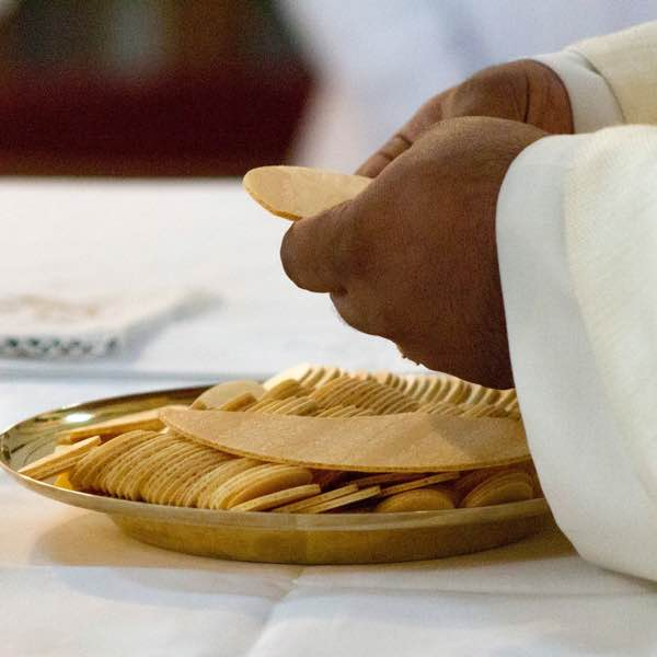 Image showing priest breaking bread during Mass
